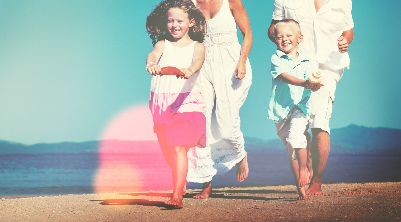 Family Running Playful Vacation Beach Holiday Concept