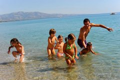 sibari_green_vilage_kids-in-shallow-water