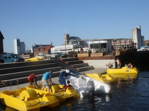 Yellow pedaloes at Odense Harbour.
